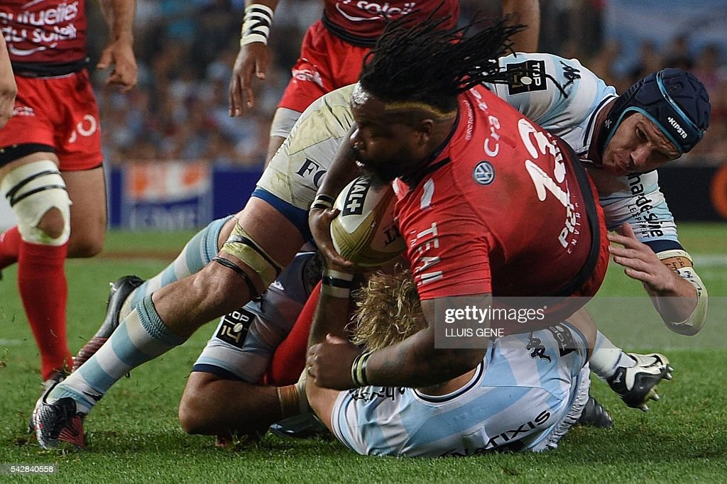 RC Toulon's French centre Mathieu Bastareaud (L) is tackled by Racing Metro 92's South African flanker Bernard Le Roux (R) during the French Top14 rugby union final match Toulon vs Racing 92 at the Camp Nou stadium in Barcelona on June 24, 2016. / AFP / LLUIS