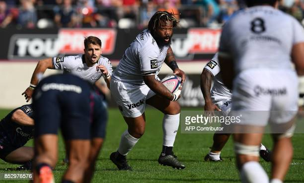 RC Toulon's French centre Mathieu Bastareaud runs with the ball during the French Top 14 rugby union match between Stade Francais and Toulon at the...
