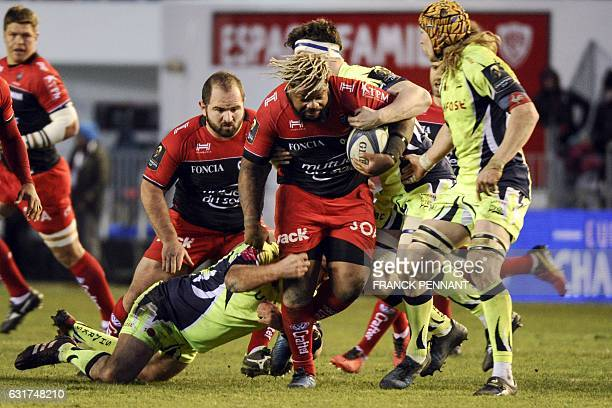 RC Toulon's French centre Mathieu Bastareaud vies with Sale's players during the European Rugby Champions Cup match between RC Toulon and Sale Sharks...