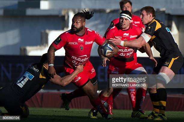 RC Toulon's French centre Mathieu Bastareaud vies with Wasps' flanker from Australia George Smith during the European Champions Cup rugby union match...