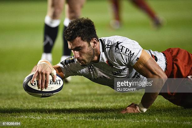 Toulon's French flanker Charles Ollivon scores a try during the European Rugby Champions Cup rugby union round 2 match between Sale Sharks and Toulon...
