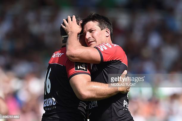 RC Toulon's French flyhalf Francois Trinh Duc reacts with a teammate during the French Top 14 rugby union match between Pau and Toulon on August 27...