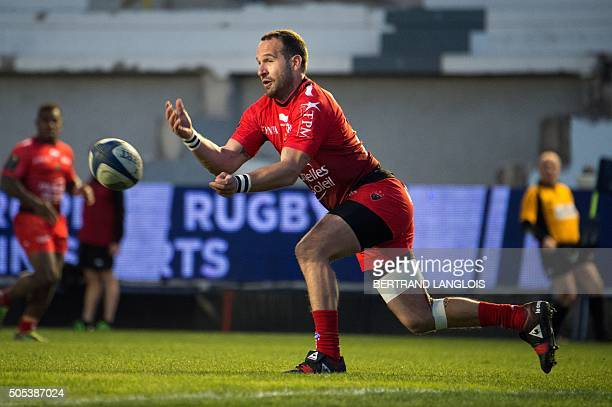 RC Toulon's French flyhalf Frederic Michalak makes a pass during the European Champions Cup rugby union match RC Toulon vs Wasps on January 17 2016...