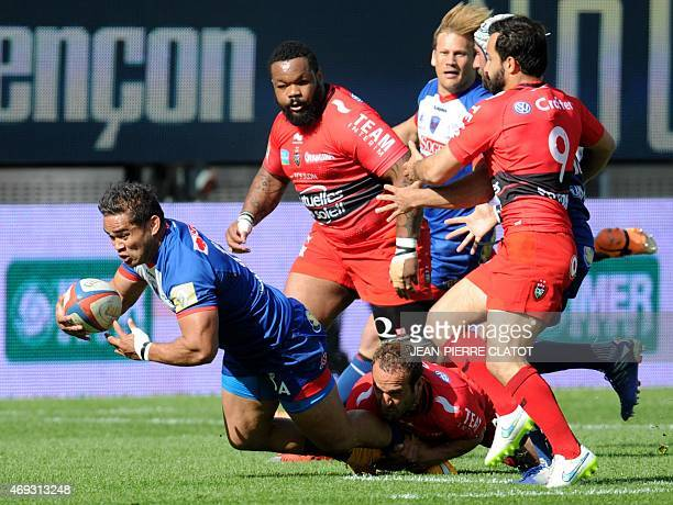 Toulon's French flyhalf Frederic Michalak tackles Grenoble'scentre Jackson Willison during the French Top 14 rugby union match Grenoble vs Toulon on...