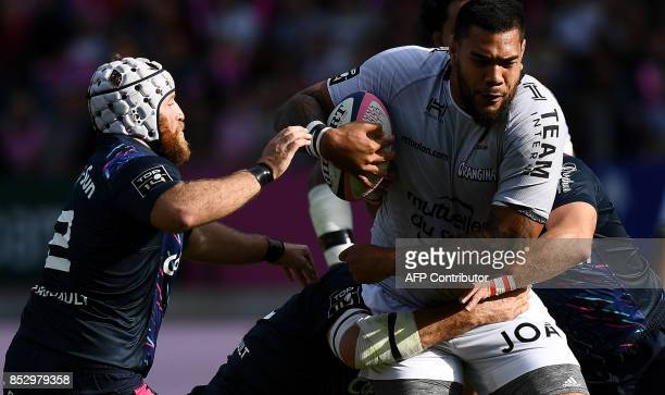 RC Toulon's French lock Romain Taofifenua is tackled next to Stade Francais Paris' French hooker Laurent Panis during the French Top 14 rugby union...