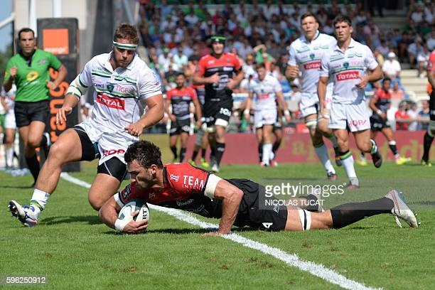 RC Toulon's French Number Eight Charles Ollivon scores a try during the French Top 14 rugby union match between Pau and Toulon on August 27 2016 at...