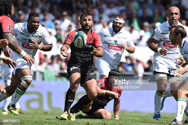 RC Toulon's French scrumhalf Eric Escande pases the ball during the French Top 14 rugby union match between Pau and Toulon on August 27 2016 at the...
