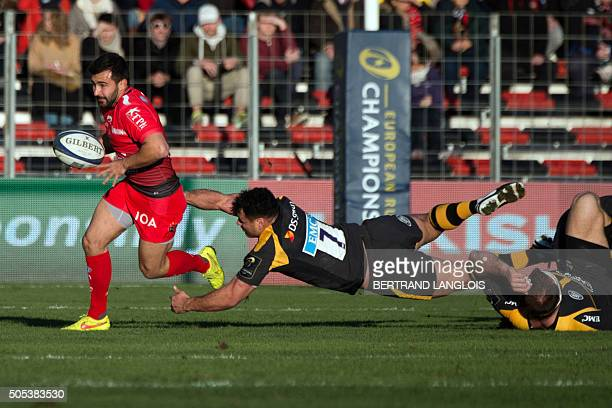 RC Toulon's French scrumhalf Eric Escande vies with Wasps' Australian flanker George Smith during the European Champions Cup rugby union match RC...