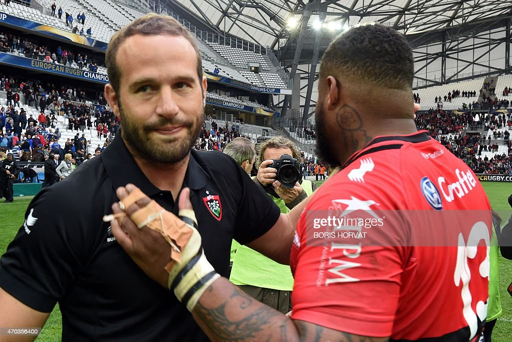 Toulon's French scrum-half Frederic Michalak (L) and Toulon's French centre <a gi-track='captionPersonalityLinkClicked' href=/galleries/search?phrase=Mathieu+Bastareaud&family=editorial&specificpeople=677501 ng-click='$event.stopPropagation()'>Mathieu Bastareaud</a> react at the end of the European Champions Cup rugby union semi final match between Toulon and Leinster on April 19, 2015 at the Velodrome stadium in Marseille, southeastern France. AFP PHOTO / BORIS HORVAT