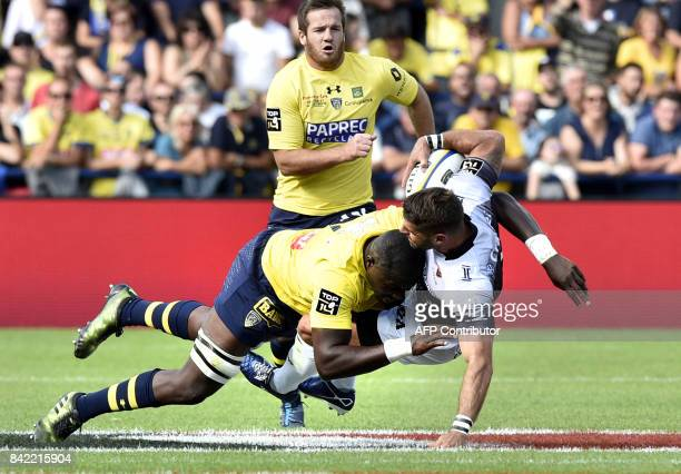 RC Toulon's French scrumhalf Sebastien TillousBorde is tackled by Clermont's French flanker Judicael Cancoriet during the French Top 14 rugby union...