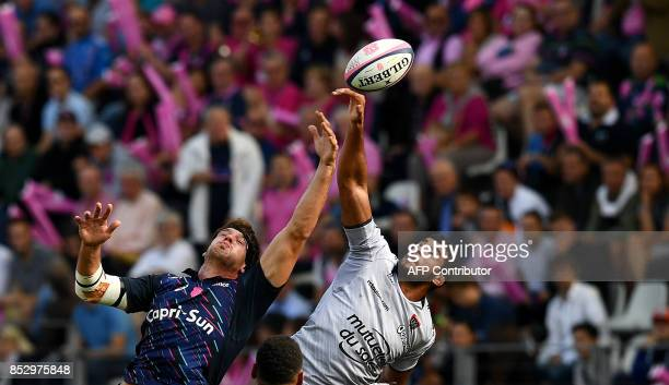 RC Toulon's FrenchAlgerian lock Swan Rebbadj and Stade Francais Paris' French lock Alexandre Flanquart jump for the ball during the French Top 14...