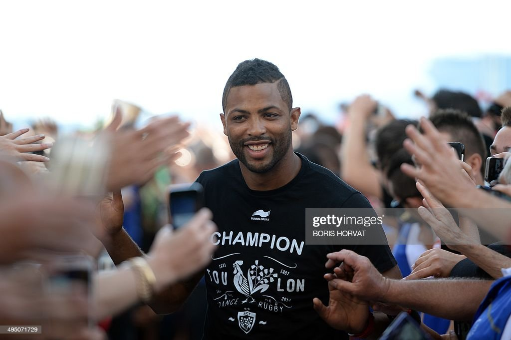 RC Toulon's fullback Delon Armitage acknowledges the crowd as the RC Toulon team greets supporters gathered in Toulon, southern France, on June 1, 2014, the day after winning the French Top 14 championship. England legend Jonny Wilkinson played a starring role in his final match as a professional as Toulon added the French Top 14 title to their European crown with an 18-10 victory over holders Castres on May 31.