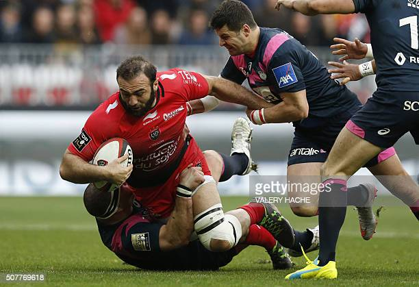 RC Toulon's Georgian flanker Mamuka Gorgodze is tackled by Stade Francais Paris' players during the French Top 14 rugby union match Toulon vs Stade...