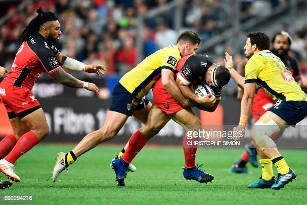 Toulon's hooker Guilhem Guirado fights for the ball with Clermont's centre Remi Lamerat during the French Top 14 rugby union final match Clermont vs...