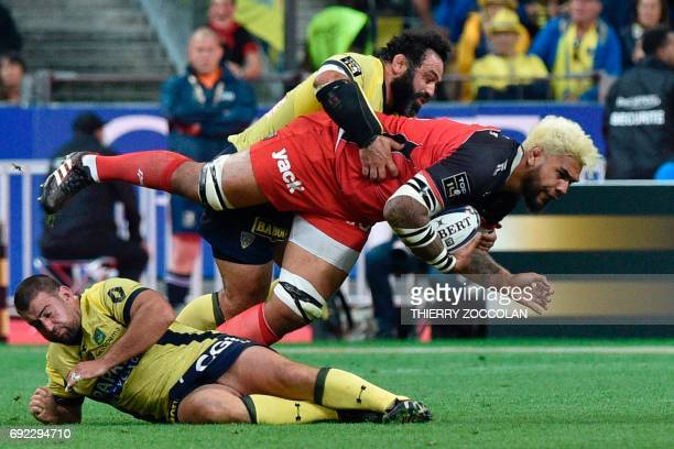 Toulon's lock Romain Taofifenua is tackled by Clermont's prop Davit Zirakachvili during the French Top 14 rugby union final match Clermont vs Toulon...