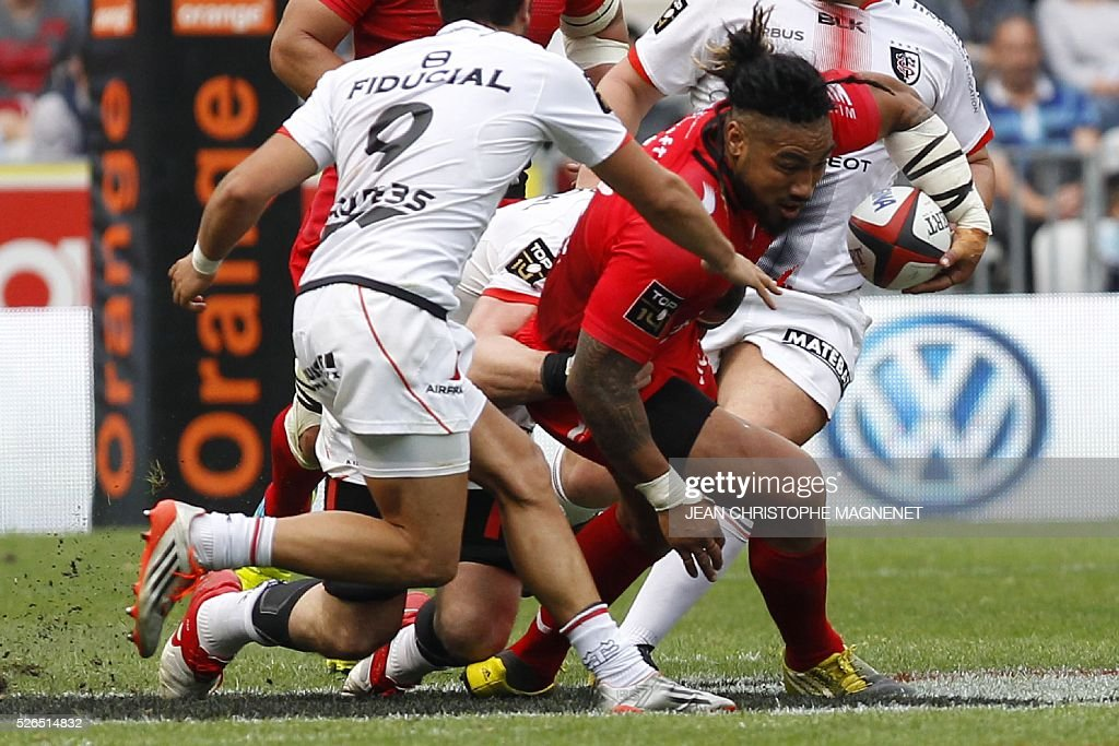 RC Toulon's New Zealand centre Maa Nonu (R) runs with the ball during the French Top 14 rugby union match Toulon vs Toulouse on April 30, 2016 at the 'Allianz Riviera' stadium in Nice, southeastern France.