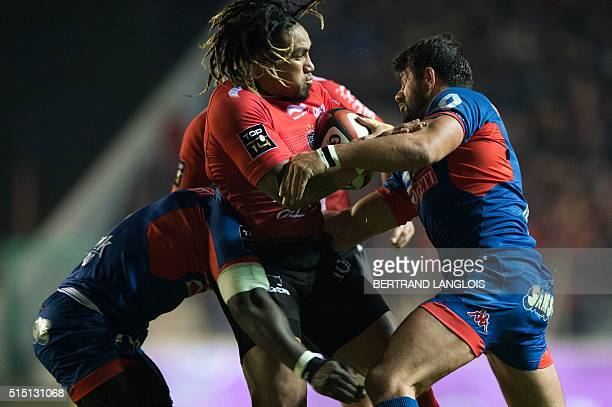RC Toulon's New Zealand centre Maa Nonu vies with Grenoble's Tongan prop Alisona Taumalolo and Grenoble's French centre Fabrice Estebanez during the...
