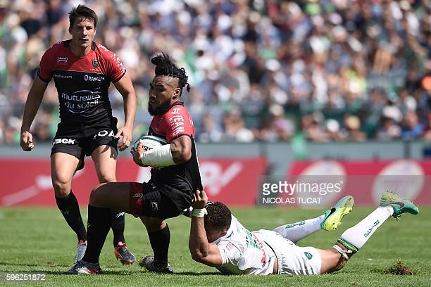 RC Toulon's New Zealander centre Ma'a Nonu is tackled during the French Top 14 rugby union match between Pau and Toulon on August 27 2016 at the...