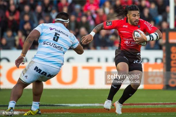 RC Toulon's New Zealander centre Ma'a Nonu outruns Racing 92's Tongan lock Edwin Maka during the French Top 14 rugby union match RC Toulon vs Racing...