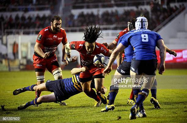 Toulon's New Zealander centre Ma'a Nonu tries to escape a tackle during the European Rugby Champions Cup rugby union match between Toulon and...