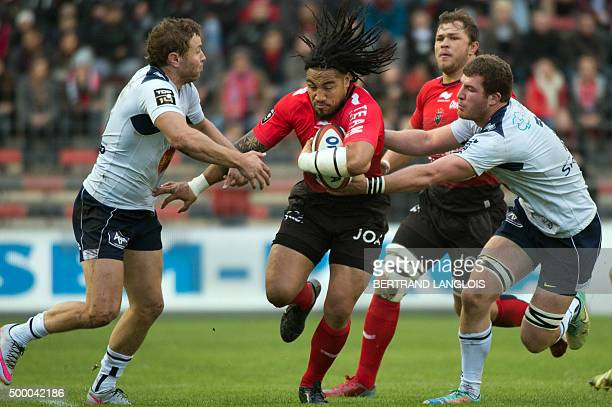 RC Toulon's New Zealander centre Maa Nonu vies with Agen's South African centre Johann Sadie and Agen's French centre Julien Heriteau during the...