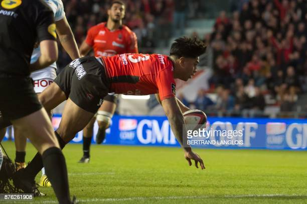 RC Toulon's New Zealander centre Malakai Fekitoa dives to score a try during the French Top 14 rugby union match RC Toulon vs Racing 92 on November...