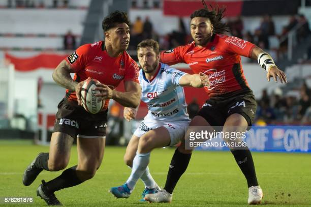 RC Toulon's New Zealander centre Malakai Fekitoa powers his way to score a try despite Racing 92's winger Marc Andreu next to teammate RC Toulon's...