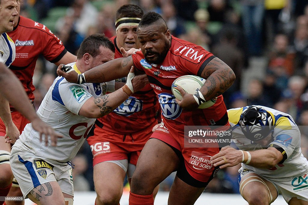 Toulon's outside centre Mathieu Bastareaud (2-R) pushes his way past Clermont Auvergne players during the European Cup final rugby union match between Toulon and Clermont Auvergne at the Aviva stadium in Dublin on May 18, 2013.
