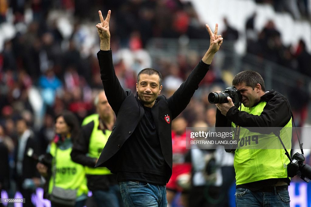 Toulon's president Mourad Boudjellal acknowledges the audience at the end of the during the European Champions Cup rugby union semi final match between Toulon and Leinster on April 19, 2015 at the Velodrome stadium in Marseille, souheastern France. AFP PHOTO / BERTRAND LANGLOIS