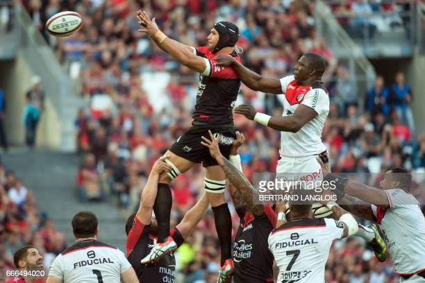 RC Toulon's South African lock Juandre Kruger vies with Toulouse's French flanker Yacouba Camara to catch the ball in a lineout during the French Top...
