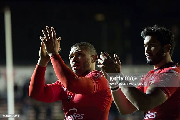 RC Toulon's South African winger Bryan Habana and RC Toulon's French centre Maxime Mermoz salute the public after the European Champions Cup rugby...