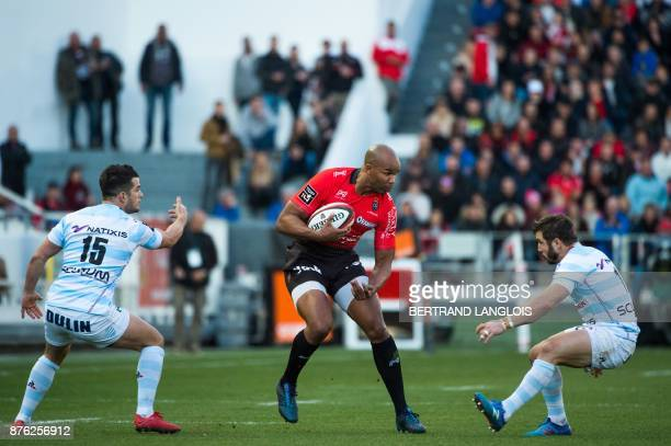 RC Toulon's South African winger JP Pietersen challenges Racing 92's winger Marc Andreu and Racing 92's fullback Brice Dulin during the French Top 14...