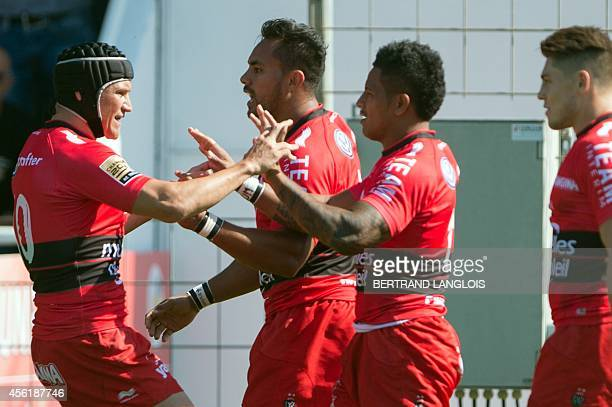 RC Toulon's winger David Smith is congratulated by RC Toulon's flyhalf Matt Giteau after scoring a try during the French Top 14 rugby union match RC...
