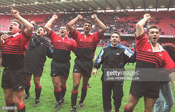 Toulouse captain Emile N'Tamack celebrates with teammates after winning the Heineken European Rugby Cup 07 January after beating Cardiff at the...