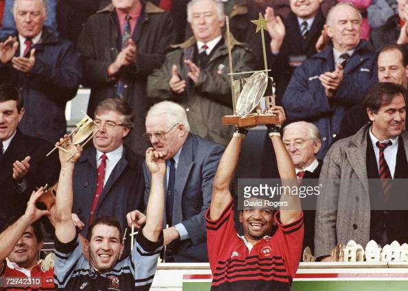 Toulouse captain Emile N'Tamack lifts the trophy and scrum half Philippe Carbonneau raises his arms aloft in celebration after the innaugural...