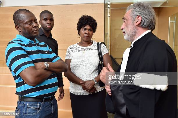 Toulouse football player Odsonne Edouard and his parents speak with his lawyer Pierre Le bonjour prior to his hearing for 'armsbased violence' on...