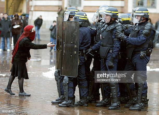 A demonstrator argues with policemen 07 March 2006 in Toulouse southern France on the sideline of a demonstration given as part of a nationwide...