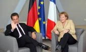 French president Nicolas Sarkozy has a meeting with German Chancellor Angela Merkel during an informal summit at Airbus A380 factory 16 July 2007 in...