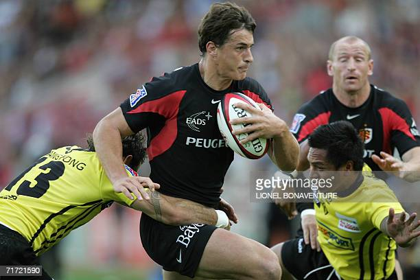 Toulouse's centre Yannick Jauzion vies with Albi's centre Lilian Subra and winger Dimitri Senio as his teammate Gareth Thomas looks on during their...