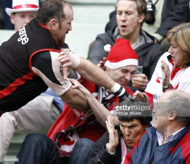 Toulouse's Irish player Trevor Brennan punches an Ulster's fans during the European cup rugby union match Toulouse vs Ulster 21 January 2007 at the...