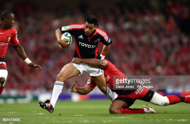 Toulouse' Maleli Kunavore tackles Munster's Lifeimi Maf during the Heineken Cup Final at the Millennium Stadium Cardiff