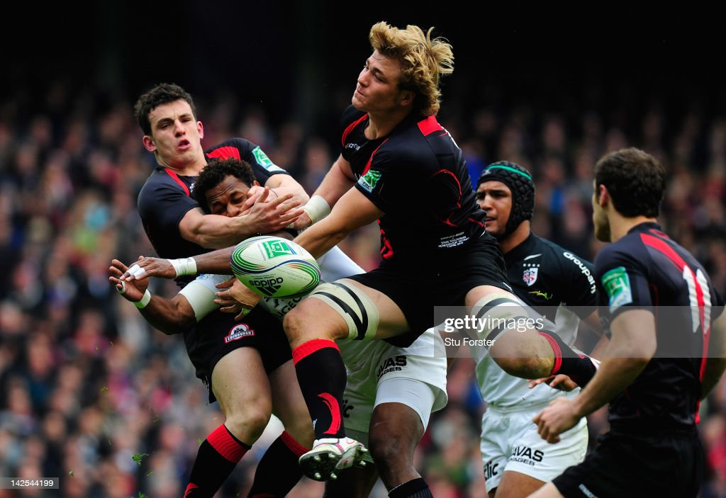 Toulouse wing Timoci Matanavou (c) looses the ball under pressure from Edinburgh centre <a gi-track='captionPersonalityLinkClicked' href=/galleries/search?phrase=Matt+Scott+-+Rugby+Union+Player&family=editorial&specificpeople=15066775 ng-click='$event.stopPropagation()'>Matt Scott</a> (l) and forward David Denton to set up the first try during the Heineken Cup Quarter Final between Edinburgh and Toulouse at Murrayfield Stadium on April 7, 2012 in Edinburgh, Scotland.