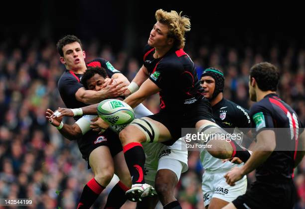 Toulouse wing Timoci Matanavou looses the ball under pressure from Edinburgh centre Matt Scott and forward David Denton to set up the first try...