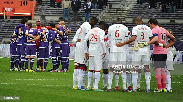 Toulouse's and Bordeaux's players stand in circles during a minute of silence in hommage to the victims of Islamist gunman Mohamed Merah during the...