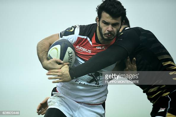 Toulouse's Arthur Bonneval escapes from a tackle during the European Rugby Champions Cup Pool 2 round 3 match Zebre Rugby vs Stade Toulousain at the...