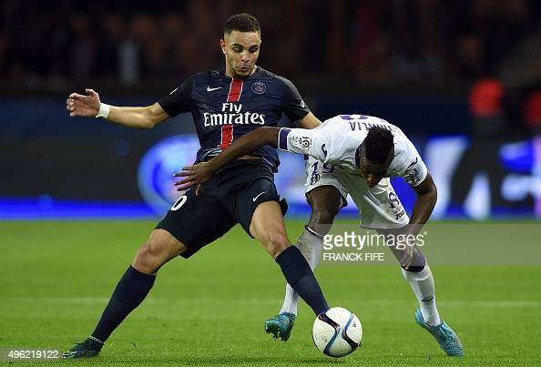 Toulouse's Brazilian midfielder Somalia vies with Paris SaintGermain's French defender Layvin Kurzawa during the French L1 football match between...