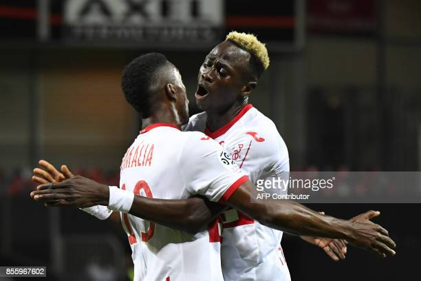 Toulouse's Brazilian midfielder Wergiton Somalia celebrates with Toulouse's Guinean defender Issiaga Sylla after scoring a goal during the French L1...