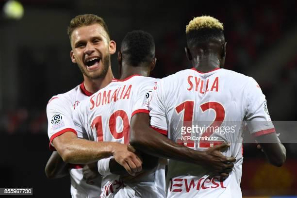 Toulouse's Brazilian midfielder Wergiton Somalia celebrates with Toulouse's French midfielder Alexis Blin and Toulouse's Guinean defender Issiaga...
