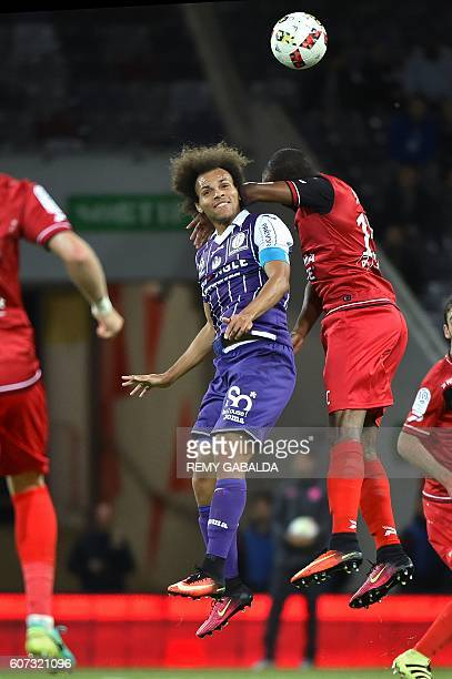 Toulouse's captain Martin Braithwaite fights for an aerial ball during the French L1 football match Toulouse against Guingamp on September 17 2016 at...