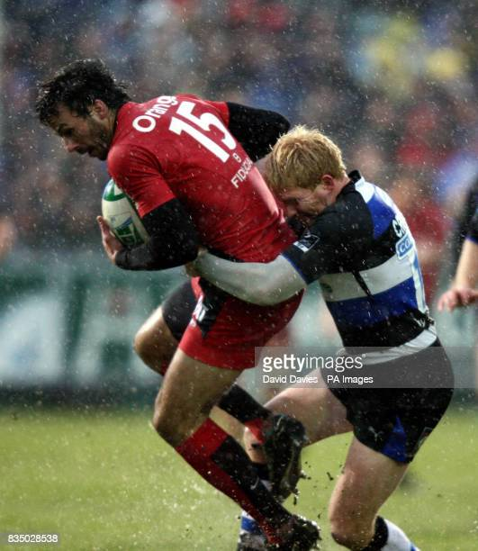 Toulouse's Clement Poitrenaud is tackled by Bath's Alex Crockett during the Heineken Cup match at The Recreation Ground Bath